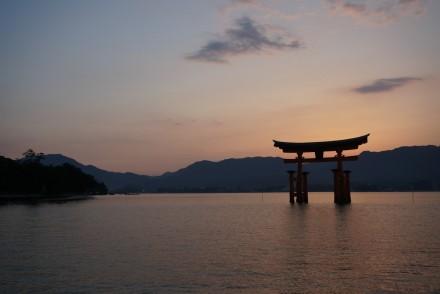 The floating Itsukushima Shrine off the Miyajima Island at sunset