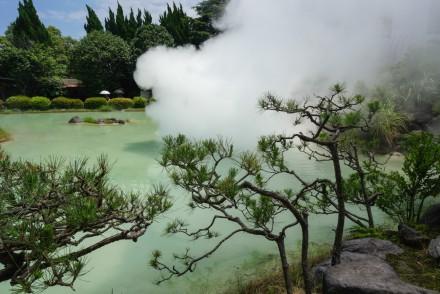 A green natural hot spring steaming at the Beppu Hells