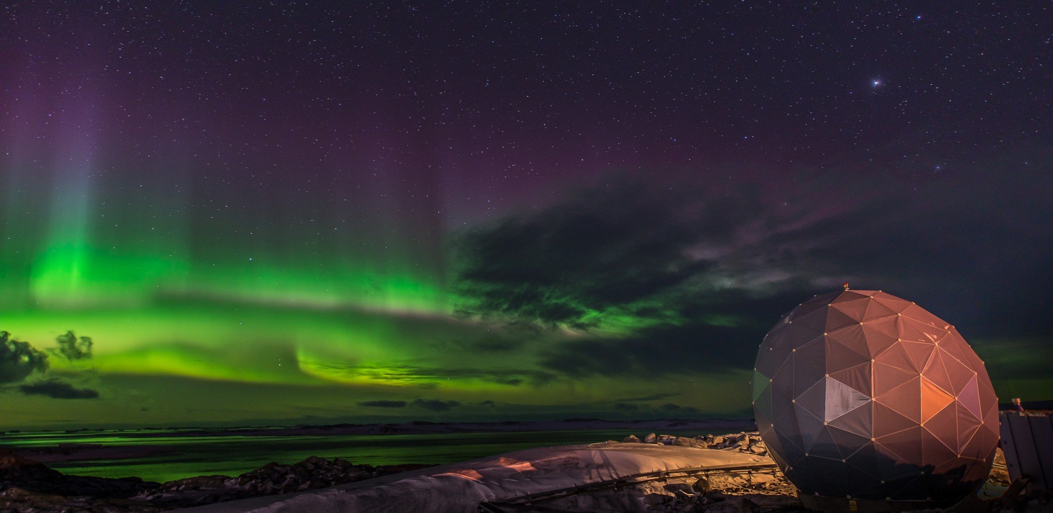 Southern Lights Over A Satellite Dome In Antarctica